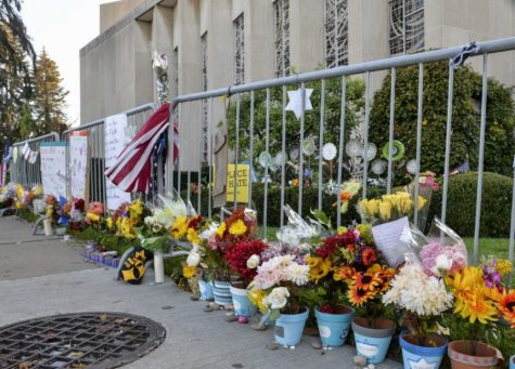 Flowers, candles and chalk drawings placed outside the Tree of Life Synagogue in 2019.