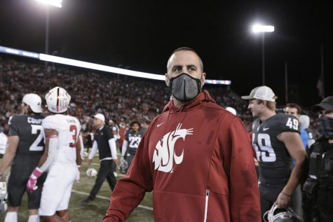 Former Washington State University head coach Nick Rolovich walks on the field after a football game against Stanford University on Oct. 16. WSU recently fired Rolovich for not following the state's vaccine mandate for public employees.