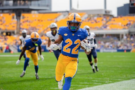 Running back Vincent Davis (22) carries the ball during the Pitt vs. New Hampshire football game on Sept. 25.