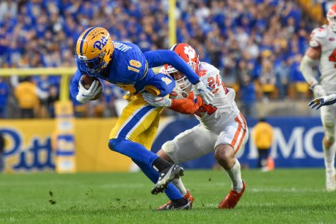 Clemson safety Nolan Turner (24) tackles Shocky Jacques-Louis (81), a first-year wide receiver, at Heinz Field on Saturday.
