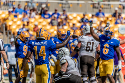 Marquis Williams (14) celebrates with other Panthers during the Pitt vs. WMU football game in September.