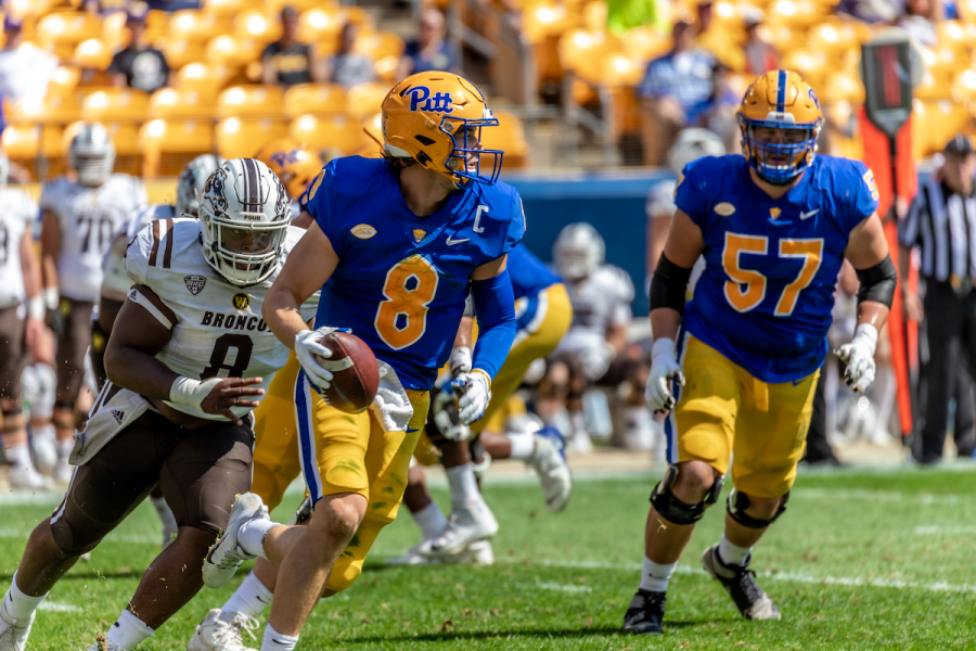 Kenny Pickett eludes the defensive rush at the Pitt vs. Western Michigan game.