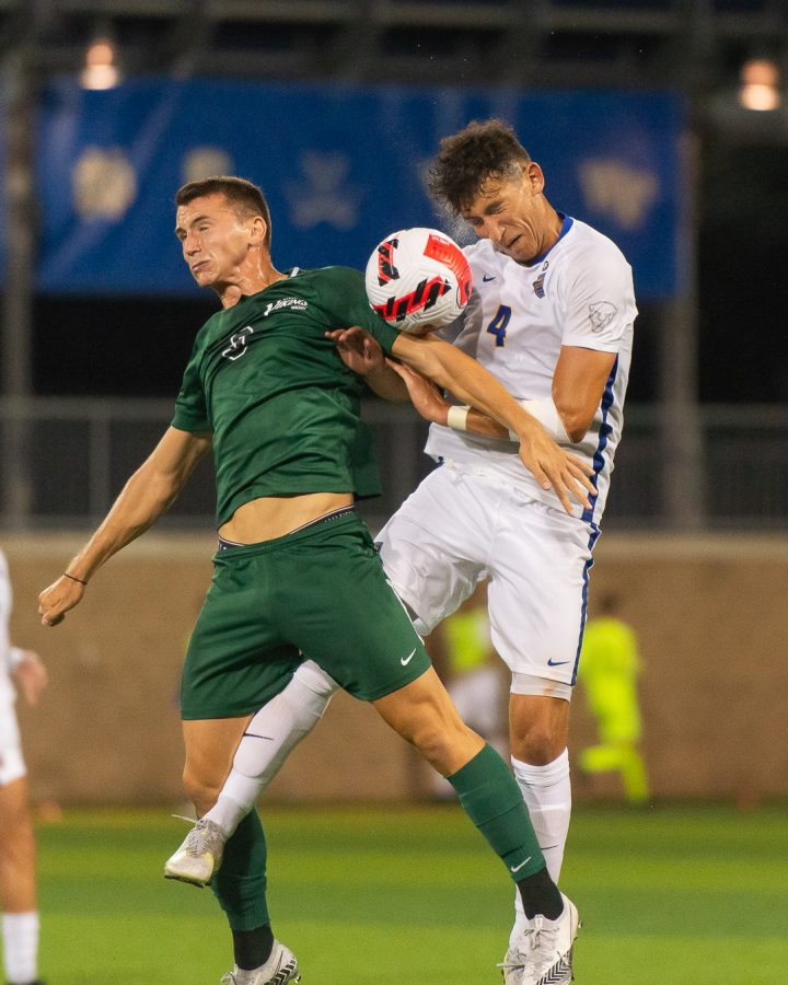 Junior defender Mohammad Abualnadi (4) collides with a Cleveland State player during Tuesday night's men's soccer game.