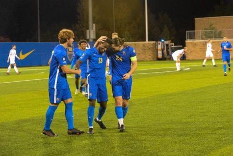 Pitt Panthers Guilherme Feitosa (7), Alexander Dexter (13) and Jackson Walti (24) celebrate a goal against UMass Monday night.