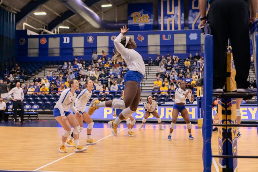 Pitt's Chinaza Ndee (5) prepares to hit the ball at a game against the University of Virginia at Fitzgerald Field House on Sept. 29.