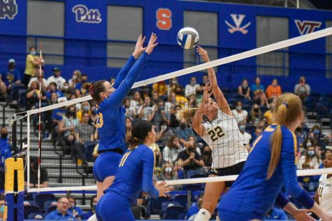 Graduate student Kayla Lund (23) prepares to bump the ball back over the net at Pitt's volleyball game against Georgia Tech at the Fitzgerald Field House on Sunday.