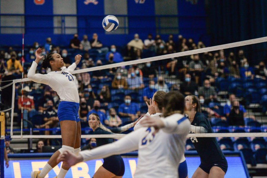 Serena Gray, senior middle blocker, transferred from Penn State this year. Pictured is Gray spiking the ball during Pitt's game against BYU.