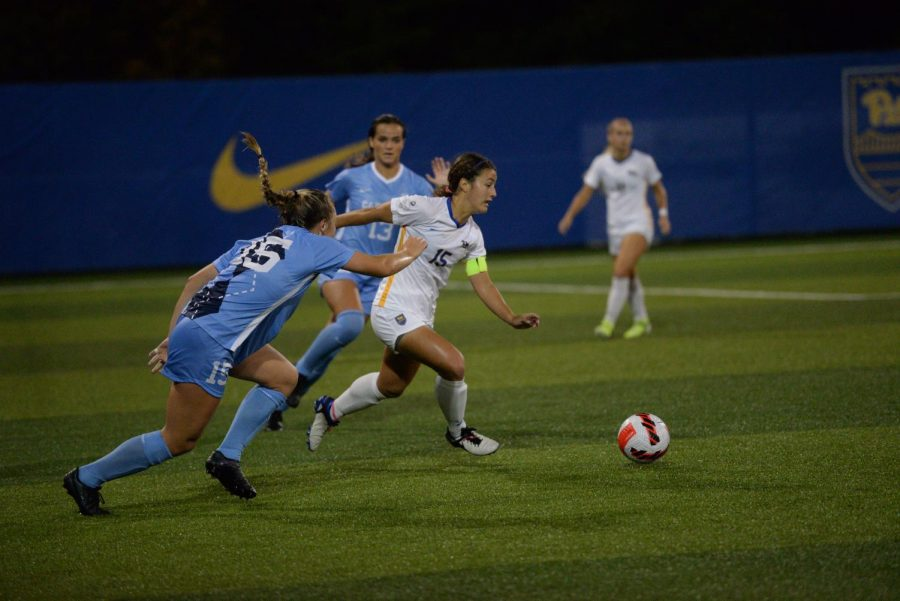 Midfielder Chloe Minas (15) runs to the ball at Ambrose Urbanic Field on Thursday night against UNC. The Panthers lost 1-0.