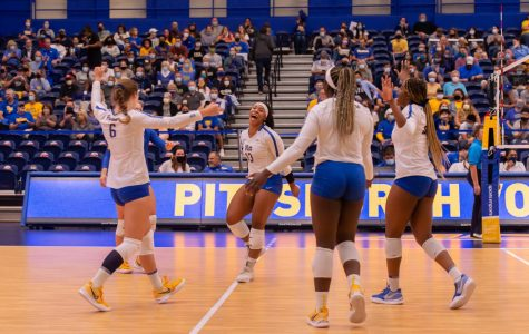 Pitt volleyball celebrates in this photo from its game against UVA in September.