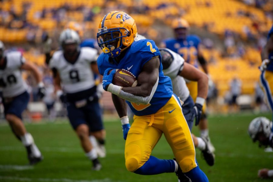 Sophomore running back Israel Abanikanda (2) carries the football against the New Hampshire Wildcats at Heinz Field on Sept. 25.