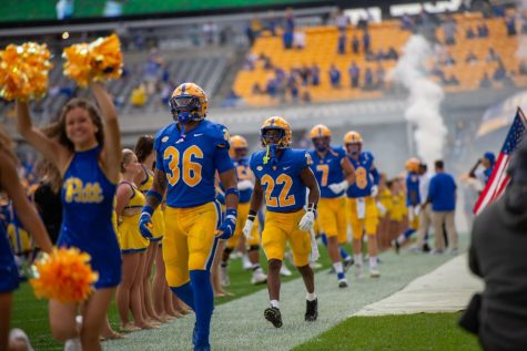 Pitt linebacker Chase Pine and P.J. O'Brien walked into the game against New Hampshire on Sept. 25 at Heinz Field.